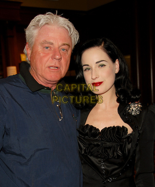"""DITA VON TEESE & FATHER KEN.signed autographs for hundreds of fans at her book signing for """"Burlesque and the Art of the Teese"""" at Book Soup at South Coast Plaza in Costa Mesa, California, USA,.April 7th 2006.half length with dad real name Heather Sweet family daughter.Ref: DVS.**Exclusive Session**.www.capitalpictures.com.sales@capitalpictures.com.©Debbie Van Story/Capital Pictures."""