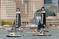 Louis Vuitton America's Cup World Series teams USA and Japan catamarans race on the Hudson River course near Brookfield Place.
