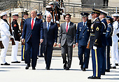United States President Donald J. Trump (L) walks past an honor guard with the new US Secretary of Defense Dr. Mark T. Esper (2nd,R), US Vice President Mike Pence (2nd,L) and US Air Force General Paul J. Selva, Vice Chairman of the Joint Chiefs of Staff (L), at the Pentagon, Thursday, July 25, 2019, Washington, DC. The Department of Defense has been without a full-time leader since former Secretary Jim Mattis resigned in December 2018.    <br /> Credit: Mike Theiler / Pool via CNP