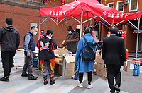 Facemasks and Hand Sanitisers are given out at two areas as Chinatown begins to open up for business again<br /> Social Distancing, Hand Sanitiser stations and NHS signage around London as Lockdown restrictions are loosened by allowing Pubs, Restaurants and all retail to re-open. London on Saturday July 4th 2020<br /> <br /> Photo by Keith Mayhew