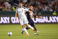 Philadelphia Union forward Carlos Ruiz (20) seems to move out of the way as LA Galaxy forward Juan Pablo Angel (9) moves with the ball. The LA Galaxy defeated the Philadelphia Union 1-0 at Home Depot Center stadium in Carson, California on  April  2, 2011....