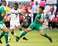 KANSAS CITY, KS - JUNE 26: Samuel Cox #8 challenges Cordell Cato #7 during a game between Guyana and Trinidad