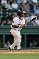 Third baseman Rafael Devers (13) of the Greenville Drive bats in a game against the Rome Braves on Monday, June 15, 2015, at Fluor Field at the West End in Greenville, South Carolina. Devers is the No. 6 prospect of the Boston Red Sox, according to Baseball America. (Tom Priddy/Four Seam Images)