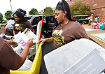 Britney Christian (right) helps move in new freshman Kai Lloyd of Chicago (not shown) during freshman move-in day at Harris-Stowe State University in St. Louis on Wednesday August 15, 2018. At left is Kristion Green, another student volunteer helping the freshmen settle in.  <br />  Photo by Tim Vizer