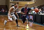 SIOUX FALLS, SD - MARCH 9:  KJ Malveau #5 of Oklahoma Wesleyan drives past Jaylen McKay #11 of IU East at the 2018 NAIA DII Men's Basketball Championship at the Sanford Pentagon in Sioux Falls. (Photo by Dick Carlson/Inertia)