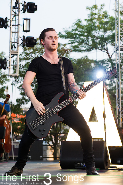 Sam Bettley of Asking Alexandria performs with Jonathan Davis at the 2014 AP Music Awards at the Rock And Roll Hall Of Fame and Museum at North Coast Harbor in Cleveland, Ohio.