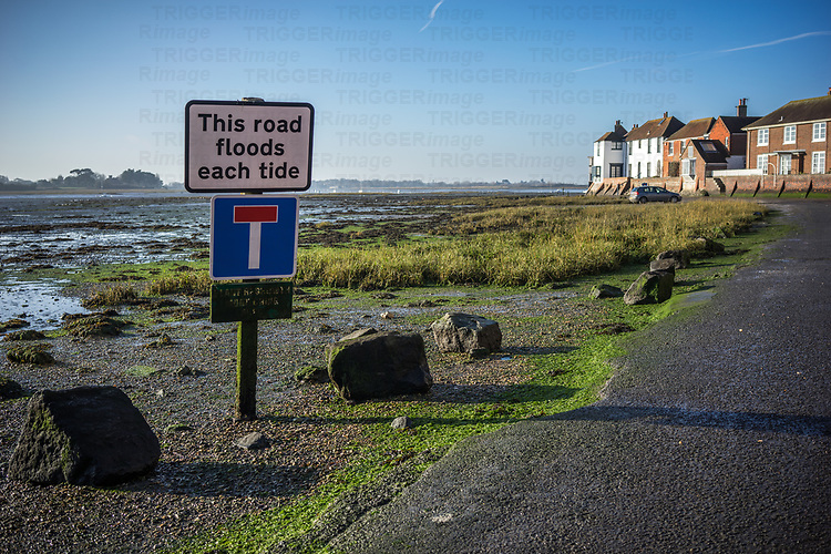 Road sign warning of flooding in Bosham, West Sussex, England