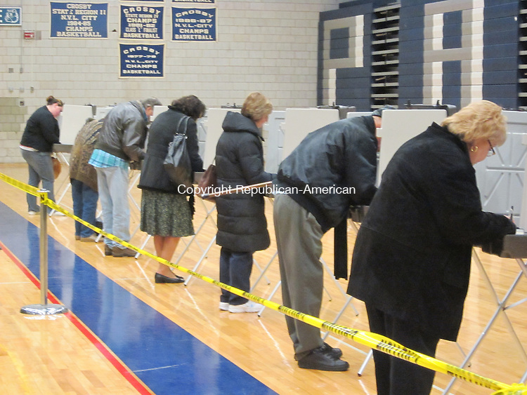 Voters cast their ballots Tuesday at Crosby High School in Waterbury Rick Harrison/RA