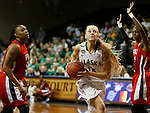 SIOUX FALLS MARCH 22:  Alysha Devine #15 of Alaska Anchorage drives between Francis Marion defenders during their quarterfinal game at the NCAA Women's Division II Elite 8 Tournament at the Sanford Pentagon in Sioux Falls, S.D.  (Photo by Dick Carlson/Inertia)