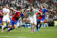 Benzema, Gareth Bale of Real Madrid and Fabian Schar of FC Basel 1893 during the Champions League group B soccer match between Real Madrid and FC Basel 1893 at Santiago Bernabeu Stadium in Madrid, Spain. September 16, 2014. (ALTERPHOTOS/Caro Marin) /NortePhoto.com