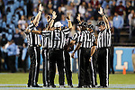 17 October 2015: The match officials huddle before the game. The University of North Carolina Tar Heels hosted the Wake Foresst University Demon Deacons at Kenan Memorial Stadium in Chapel Hill, North Carolina in a 2015 NCAA Division I College Football game. UNC won the game 50-14.