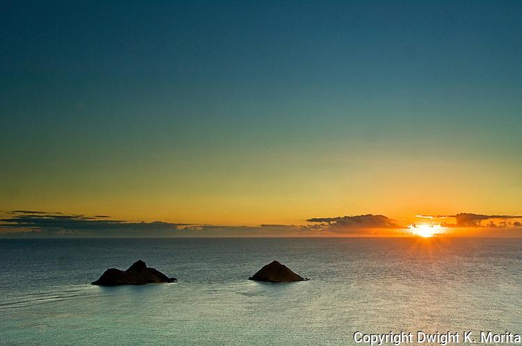 Sunrise shines on Mokulua Islands at beginning of a new day.