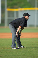 Umpire Sam Dodson handles the calls on the bases during the Appalachian League game between the Burlington Royals and the Bristol Pirates at Boyce Cox Field on July 10, 2015 in Bristol, Virginia.  The Pirates defeated the Royals 9-4. (Brian Westerholt/Four Seam Images)