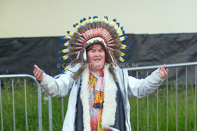 WWW.ACEPIXS.COM<br /> <br /> July 12 2015, Strathallen Castle<br /> <br /> Susan Boyle wore a native American head dress as she paid a visit to T In The Park at its new home of Strathallen Castle on July 12 2015 in Scotland<br /> <br /> By Line: Famous/ACE Pictures<br /> <br /> <br /> ACE Pictures, Inc.<br /> tel: 646 769 0430<br /> Email: info@acepixs.com<br /> www.acepixs.com