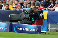 A TV cameraman recovers after being hit by the ball during Sweden Under-21 vs England Under-21, UEFA European Under-21 Championship Football at The Kolporter Arena on 16th June 2017