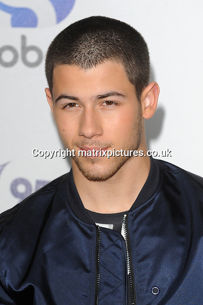 NON EXCLUSIVE PICTURE: PAUL TREADWAY / MATRIXPICTURES.CO.UK<br /> PLEASE CREDIT ALL USES<br /> <br /> WORLD RIGHTS<br /> <br /> American singer Nick Jonas attends The Capital FM Summertime Ball at Wembley Stadium in London.<br /> <br /> JUNE 6th 2015<br /> <br /> REF: PTY 151822