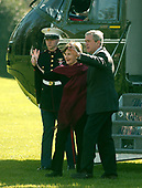 Washington, D.C. - November 25, 2006 -- United States President George W. Bush and first Lady Laura Bush wave to friends as they arrive on the South Lawn of the White House after spending the Thanksgiving Day week-end at Camp David on Saturday, November 25, 2006.  <br /> Credit: Ron Sachs - Pool