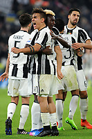 Calcio, Serie A: Juventus vs Milan. Torino, Juventus Stadium, 10 marzo 2017.<br /> Juventus&rsquo; Paulo Dybala, foreground celebrates with his teammate Moise Kean after scoring on a penalty kick the winning goal during the Italian Serie A football match between Juventus and AC Milan at Turin's Juventus Stadium, 10 March 2017. Juventus won 2-1.<br /> UPDATE IMAGES PRESS/Manuela Viganti