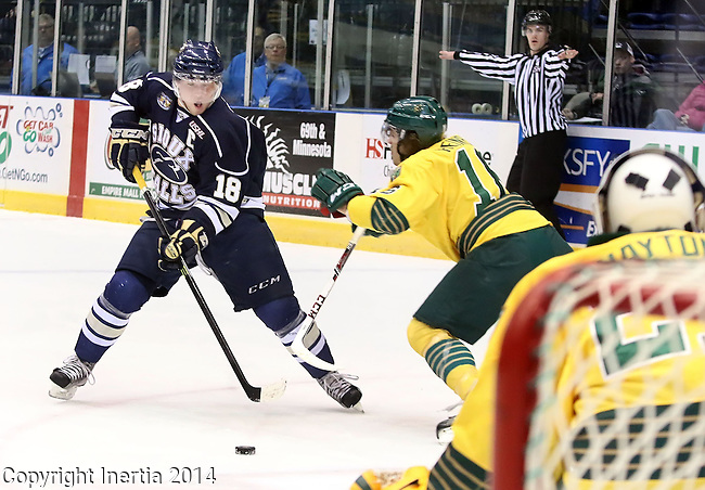 SIOUX FALLS, SD - JANUARY 17:  Dennis Kravchenko #18 from the Sioux Falls Stampede weaves his way up the ice as Blake Heinrich #16 from the Sioux City Musketeers defends in the first period Friday night at the Sioux Falls Arena. (Photo by Dave Eggen/Inertia)