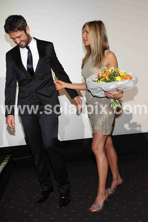 **ALL ROUND PICTURES FROM SOLARPIX.COM**.**SYNDICATION RIGHTS FOR UK AND SPAIN ONLY**.Arrivals for the gala screening of the new film The Bounty Hunter at Cinemaxx in Berlin, Germany. 29 March 2010...This pic: Jennifer Aniston and Gerard Butler..JOB REF: 11016 CPR Stadler       DATE: 29_03_2010.**MUST CREDIT SOLARPIX.COM OR DOUBLE FEE WILL BE CHARGED**.**MUST NOTIFY SOLARPIX OF ONLINE USAGE**.**CALL US ON: +34 952 811 768 or LOW RATE FROM UK 0844 617 7637**