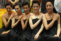 "Models show off diamon rings for sale at the ""Top Show"" luxury gods fair in Shenzhen, China."