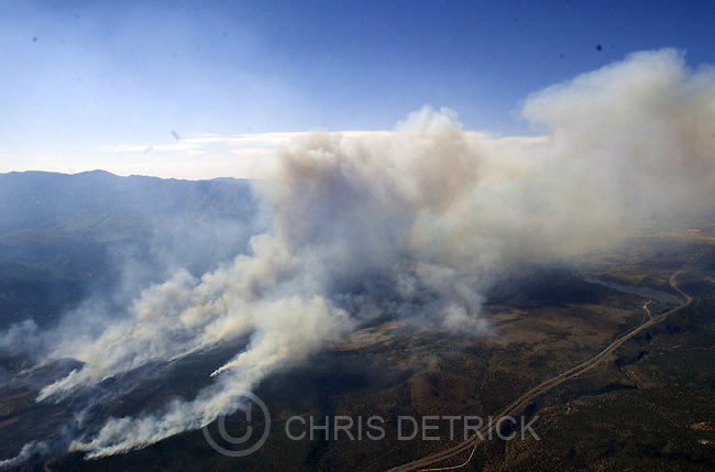 Toquerville,Utah--6/26/2005- .**This is the view from the Channel 2 Helicopter.** NORTH WEST VIEW..The Blue Springs fire continues to burn to the North, West and South of I-15 (as seen in the lower right corner).  Over 8,000 acres have burned so far in the blaze that started around 3pm Saturday afternoon. .** Pictures from the West Side Complex Fire..Photo By: Chris Detrick /Salt Lake Tribune.File #816G5111