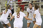 06 December 2013: Florida State's Kristen Grubka (13) celebrates her goal with teammates Berglind Thorvaldsdottir (ISL) (10), Michaela Hahn (8), and Kassey Kallman (9). The Florida State Seminoles defeated the Virginia Tech University Hokies 3-2 at WakeMed Stadium in Cary, North Carolina in a 2013 NCAA Division I Women's College Cup semifinal match.