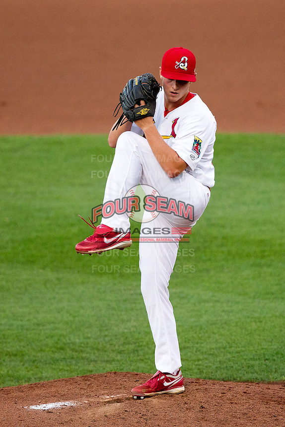Seth Maness (27) of the Springfield Cardinals winds up during a game against the Arkansas Travelers at Hammons Field on June 12, 2012 in Springfield, Missouri. (David Welker/Four Seam Images)