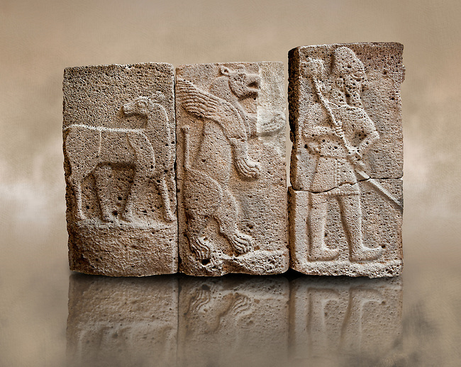 Late Hittite (Aramaean)  Basalt relief sculptures  from 9th Cent B.C, excavated from the west side of the citadel gate of Sam'al (Hittite: Yadiya) located at Zincirli Höyük in the Anti-Taurus Mountains of modern Turkey's Gaziantep Province. Left Deer Buck, Inv no 7712, Middle Winged Lion inv no. 7706, Left Male with Axe Inv No. 7727. Istanbul Archaeological Museum.