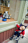 Child at store window with toy dogs<br />