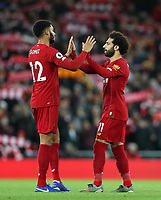 2nd January 2020; Anfield, Liverpool, Merseyside, England; English Premier League Football, Liverpool versus Sheffield United; Mohammed Salah of Liverpool high fives team mate Joe Gomez of Liverpool prior to the kick off  - Strictly Editorial Use Only. No use with unauthorized audio, video, data, fixture lists, club/league logos or 'live' services. Online in-match use limited to 120 images, no video emulation. No use in betting, games or single club/league/player publications