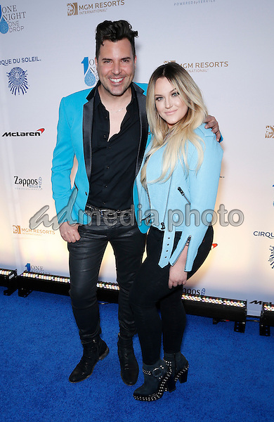 18 March 2016 - Las Vegas, Nevada - Frankie Moreno, Lacey Schwimmer. Cirque Du Soleil presents star-studded blue carpet at Fourth Annual One Night for ONE DROP at the Cleveland Clinic Lou Ruvo Center for Brain Health. Photo Credit: MJT/AdMedia