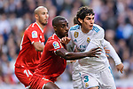 Lionel Carole of Sevilla FC (L) fights for position with Jesus Vallejo of Real Madrid (R) during La Liga 2017-18 match between Real Madrid and Sevilla FC at Santiago Bernabeu Stadium on 09 December 2017 in Madrid, Spain. Photo by Diego Souto / Power Sport Images