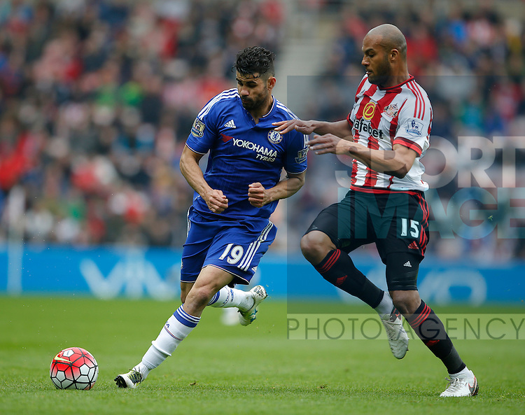 Diego Costa of Chelsea tussles with Younes Kabul of Sunderland during the Barclays Premier League match at the Stadium of Light, Sunderland. Photo credit should read: Simon Bellis/Sportimage