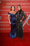 Jamie Kern Lima (left) - CEO of IT Cosmetics and Sunhee Grinnell - Beauty Director for Vanity Fair, arrive at The Fashion Group International's Night of Stars 2017 gala at Cipriani Wall Street on October 26, 2017.