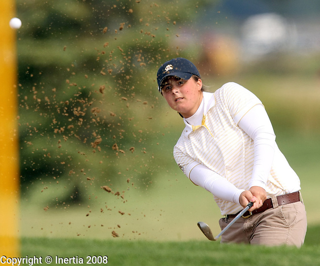 SIOUX FALLS, SD - SEPTEMBER 8: Laura Stautz of Augustana blasts out of the sand on the fifth hole at Bakker Crossing Monday morning during  the final round of the Augustana Fall Invitational. (photo by Dave Eggen/Inertia)