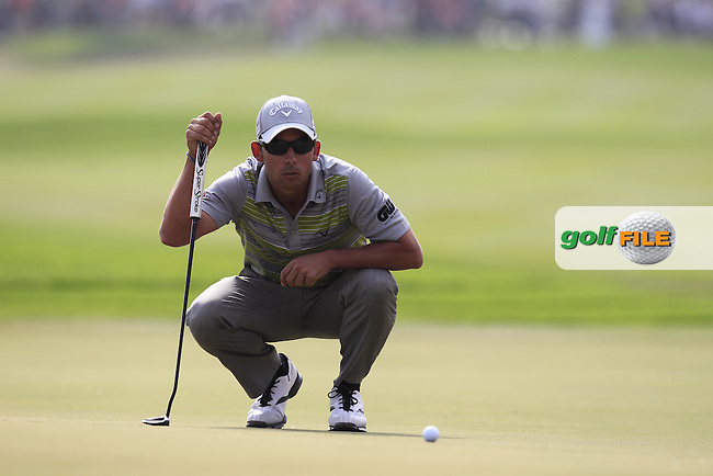 Pablo Larrazabal (ESP) lines up his putt on the 18th green during Sunday's Round 3 of the Abu Dhabi HSBC Golf Championship 2014 at the Abu Dhabi Gold Club, Abu Dhabi, United Arab Emirates.19th January 2014.<br /> Picture: Eoin Clarke www.golffile.ie