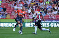 Swansea City's Mike van der Hoorn vies for possession with Sheffield United's Leon Clarke during the Sky Bet Championship match between Sheffield United and Swansea City at Bramall Lane, Sheffield, England, UK. Saturday 04 August 2018