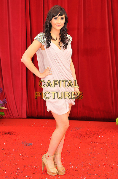 JACQUELINE JOSSA.Attending the British Soap Awards 2011, .Granada Television Studios, Quay Street, Manchester, England, UK, .March 14th 2011..arrivals full length pink beige dress ruched beaded shoulders hand on hip french connection .CAP/CAS.©Bob Cass/Capital Pictures.