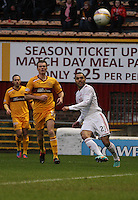 Josh Magennis (right) has a shot watched by Simon Ramsden (centre) and Tom Hateley in the Motherwell v Aberdeen, Clydesdale Bank Scottish Premier League match at Fir Park, Motherwell on 26.12.12.