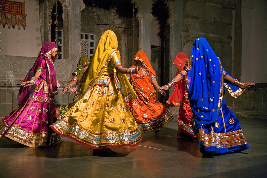 Rajasthani women perform a traditional DANCE in their colorful silk dresses at the BAGORE KI HAVELI in UDAIPUR - RAJASTHAN, INDIA