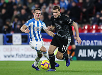 Burnley's Chris Wood competing with Huddersfield Town's Jonathan Hogg<br /> <br /> Photographer Andrew Kearns/CameraSport<br /> <br /> The Premier League - Huddersfield Town v Burnley - Wednesday 2nd January 2019 - John Smith's Stadium - Huddersfield<br /> <br /> World Copyright © 2019 CameraSport. All rights reserved. 43 Linden Ave. Countesthorpe. Leicester. England. LE8 5PG - Tel: +44 (0) 116 277 4147 - admin@camerasport.com - www.camerasport.com