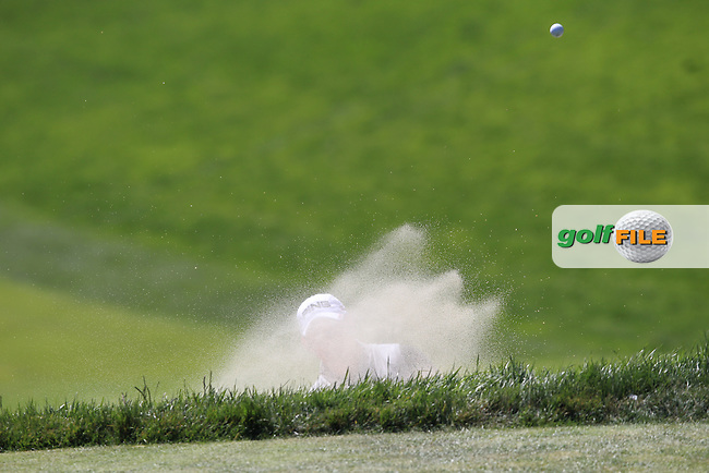 Lee Westwood (ENG) chips from a bunker at the 18th green during Friday's Round 2 of the 112th US Open Championship at The Olympic Club, San Francisco,  California, 15th June 2012 (Photo Eoin Clarke/www.golffile.ie)