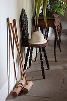 Croquet mallets are propped against the wall in the stone-flagged hallway