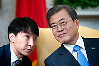 Korean President Moon Jae-in (R) listens to his translator (L) while meeting with US President Donald J. Trump (not pictured) in the Oval Office of the White House in Washington, DC, USA, 11 April 2019. President Moon is expected to ask President Trump to reduce sanctions on North Korea in an attempt to jump start nuclear negotiations between North Korea and the US.<br /> Credit: Jim LoScalzo / Pool via CNP/AdMedia
