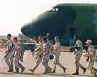 American soldiers celebrate their departure from Somalia while walking to their plane on the tarmac at Mogadish, Somalia in February, 1993 during America intervention into the ongoing famine in the country.