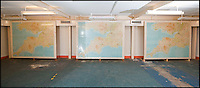 BNPS.co.uk (01202 558833)<br /> Pic: PhilYeomans/BNPS<br /> <br /> The vast Map room.<br /> <br /> Fed up with your neighbours...This Cold War bunker boasting 56 rooms, metre thick walls and no windows could be the perfect country retreat.<br /> <br /> The former top secret nuclear bunker on a remote Devon clifftop was built to shelter local officials in the chilling event of a Soviet strike on nearby Plymouth.<br /> <br /> The 30,000 sq ft shelter, built at the height of the Cold War in 1952, boasts heavy steel blast doors and its 375 kva generator can provide enough heat and light to keep up to 150 people safe for several months.<br /> <br /> It's 56 rooms were kitted out as bedrooms, living spaces, and mess rooms so that the administration could continue running the county even after a nuclear strike.<br /> <br /> Codenamed Hope Cove R6, it was finally decommissioned in 1999 and bought by local farmers Trevor Lethbridge and his friend Derek Brooking, who have used it as an archive storage system and a venue for charity and art events.<br /> <br /> The pair are now selling it through Clive Emson Auctioneers in Maidstone, Kent.