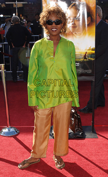 "ALFRE WOODARD.Premiere of the film ""Dreamer"". Mann Village Theatre, Westwood, CA..9th October 2005.Ref: MOO.full length brown trousers green silk satin sunglasses shades.www.capitalpictures.com.sales@capitalpictures.com.©Capital Pictures."