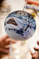 A winter scene has been painted on a Christmas bauble