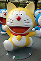 "July 16, 2014, Tokyo, Japan - The statues of the Japanese manga series ""Doraemon"" at Roppongi Hills on July 16, 2014. Sixty-six different statues of popular Japanese cartoon character Doraemon are lined up in front of the Mori Tower as a part of TV Asahi's ""Summer Station"" activities which will held from July 19 to August 24. (Photo by Rodrigo Reyes Marin/AFLO)"